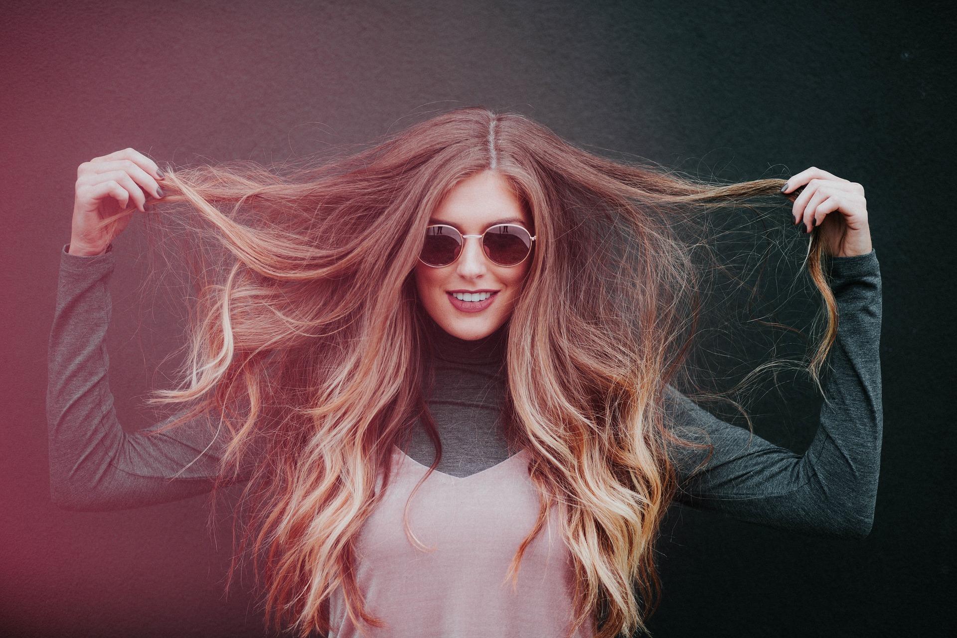 woman holding long hair